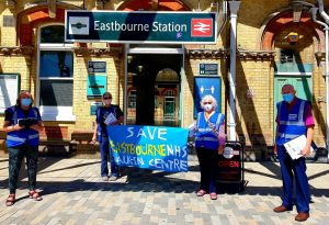 Image of campaigners outside Eastbourne station
